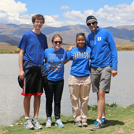 Duke students pause while taken air samples in Bolivia.