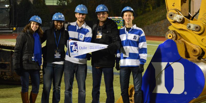 Duke civil engineering students and alums with equipment in Wallace Wade Stadium
