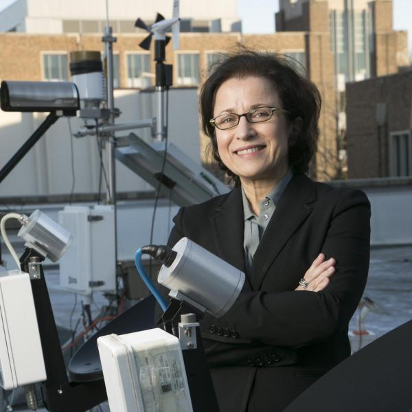 Professor Ana Barros works with equipment on the roof of Hudson Hall