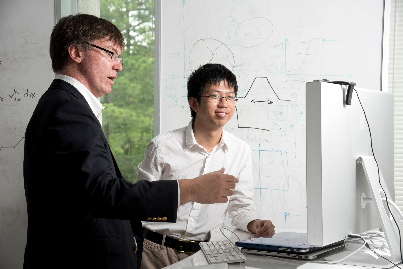 CEE PhD graduate Yingjie Liu works with his advisor, Professor John Dolbow, at his office in Gross Hall