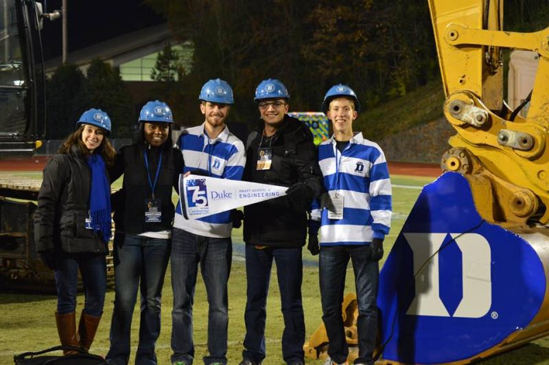 Duke civil engineering students and alums met for the last Duke Football game of the season at Wallace Wade Stadium and posed, as engineers do, with the big machines that were part of the groundbreaking for stadium renovations: Evan Lucas, '17, Zach Wiener, '15, Zach Ford, '16, Anita Brown, '16 and Rachel Fleming, '12.