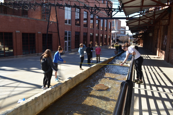 Students take water flow measurements at the American Tobacco Campus in Durham, NC.